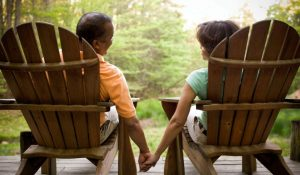 couple sitting in adirondack chairs