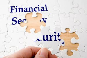 hand putting pieces in puzzle that spells financial security westchester ny mount kisco financial planner