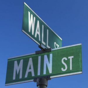 investment management mount kisco ny street sign showing intersection of main street and wall street