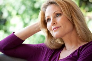 woman pondering financial aspects of divorce mount kisco ny