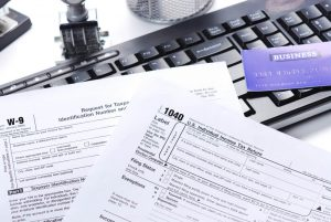 tax return and computer in financial advisors office mount kisco westchester ny